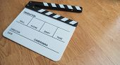 Clapper Board Or Movie Slate Use In Video Production Or Movie And Cinema Industry. Put On Wood Backg poster