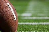 stock photo of football field  - Pro American Football on the Field Close Up with room for copy - JPG