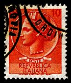 ITALY- CIRCA 1968:A stamp printed in Italy shows image of Italia with mural crown after Medallion from Syracuse, circa 1968.