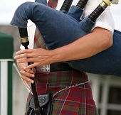 The hands of a female piper in action