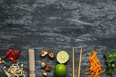 Ingredients For Asian Dish. Dried Asian Soba Noodles With Different Ingredients On Wooden Background poster