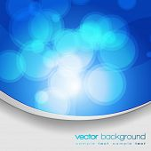 EPS10 Glittering blue lights background with text - vector