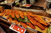 Giant Japanese Grilled Eels Fish (anguilla Japonica) For Sale With Japanese Price Label At Kuromon I poster