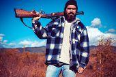 Clothes For The Hunter. Hunter With Shotgun Gun On Hunt. Man Holding Shotgun. Small Game. Hunting Gu poster
