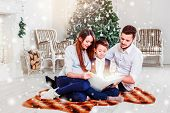 Happy Family Reading Christmas Fairy Tales Near The Xmas Tree. Living Room Decorated By Christmas Tr poster