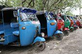 Tuk-tuk minicabs waiting for business in Sri Lanka