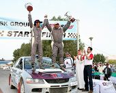 Champion Qatari rally driver Khalifa bin Khalifa al-Attiyah (right) and co-driver Nasser al-Kuwari celebrate winning Round 1 of the NBK Qatar Rally 2007, on Jan 27.