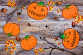 Spooky Pumpkin Gingerbread Cookies And Candy Corns On Halloween Decorated Background. Halloween Trea poster
