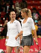 Martina Hingis (left) and Maria Kirilenko savour victory in the doubles semi-final at Qatar Total Open, March 2, 2007