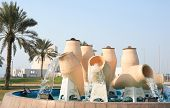 The landmark water-pots fountain on the Corniche road in the centre of Doha, Qatar, Arabia. The Isla