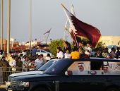 DOHA, QATAR - DECEMBER 18: Qatari families celebrate Qatar National Day with a cavalcade on the Corn