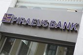 HERAKLION, GREECE - JULY 27: A Piraeus Bank, Heraklion (Iraklio), Crete branch sign. In June 2011 Pi
