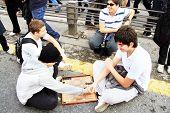 Children play backgammon on the bridge