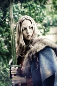 image of valkyrie  - Beautiful blond sexy woman warrior with sword outdoor - JPG