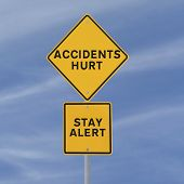 image of workplace accident  - Road sign with a safety reminder against a blue sky background - JPG