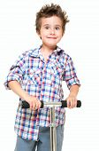 stock photo of fidget  - Naughty hairy little boy in shorts and shirt with scooter isolated on white - JPG