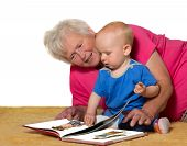 Grandmother And Baby Reading A Book