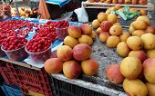 West Indian cherry , Acerola small cherry fruit with high quantity C Vitamin ,Mango-at the Market in