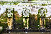 stock photo of cave woman  - Fountains at Goa Gajah Temple Ubud Bali Indonesia - JPG