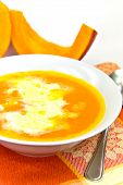 A Bowl With Hot Soup Of Baked Pumpkin With Cream