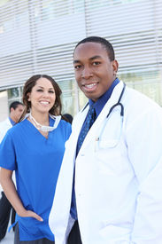 picture of medical assistant  - A happy and successful medical team outside hospital building - JPG
