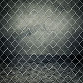 foto of chain link fence  - Obsolete gray grunge concrete room closed with chain link fence - JPG