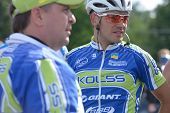 KIEV, UKRAINE - MAY 24: Vitaly Buts with teammates from Kolss cycling team, Ukraine, on the finish o