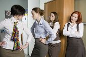 Two Colleagues Quarrel. Woman Look At Conflict.