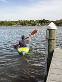 Mature Man Kayaking For Fun And Fitness