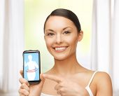 beautiful woman pointing at smartphone with application