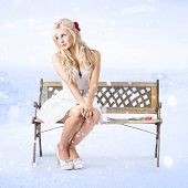 Cold And Lonely Winter Woman Sitting All Alone