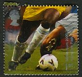 UK - CIRCA 2000: A stamp printed in UK shows image of the Football Players (Hampden Park, Glasgow),
