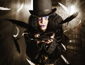 picture of jestering  - Charming portrait of an elegant fashion girl making a magic wish in top hat stylish black haircut and jester make up - JPG