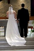 foto of married couple  - young couple at the altar about to get married - JPG