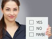 Business Smiling Woman Holding Blank With Yes, No, Maybe Options On Grey