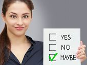 Business Smiling Woman Holding Test Blank With Maybe Decision On Grey