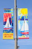 LONG BEACH, CA - September 21, 2012:  Shoreline Village banners on a light pole, Long Beach, Califor