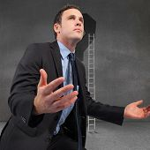 image of punctuation  - Businessman posing with arms out against punctuation in grey room - JPG