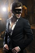 stock photo of masquerade  - Handsome young beauty  man in black mask - JPG