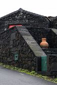 Orange Amphora On Black Wall, Pico Island, Azores Archipelago (portugal)