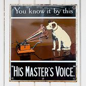 NR SOUTHAMPTON,UK - 25 June 2013: Old style tin advertising board for His Master's Voice displayed o