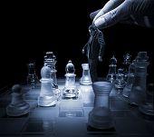 Businessman on a chessboard as a dummy