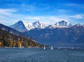 Lake Thun with Jungfrau mountain range near Oberhofen, Switzerland