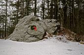 pic of blanket snow  - The spirit of Christmas is evident on the large rock decorated with a wreath and blanketed with a light snow - JPG
