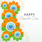 stock photo of ashoka  - Happy Indian Republic Day concept with beautiful flowers in national flag colors with Ashoka Wheel on grey background - JPG