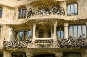 BARCELONA, SPAIN - SEPTEMBER 9, 2013: Facade with balconies, Casa Mila (La Pedrera), building constructed between 1906 and 1912 by the architect Antoni Gaudi and declared UNESCO World Heritage