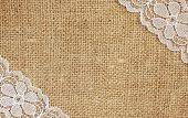 foto of primite  - Canvas background with white lace in corners - JPG