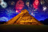 stock photo of firework display  - New Years firework display at pyramid of Kukulcan in Chichen Itza - JPG