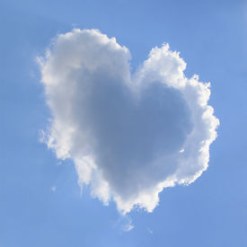 stock photo of heart shape  - naturally heart shaped cloud in a blue spring afternoon sky - JPG