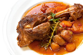 stock photo of lamb shanks  - Slow-cooked lamb shank with vegetables. Delicious homely goodness. ** Note: Shallow depth of field - JPG